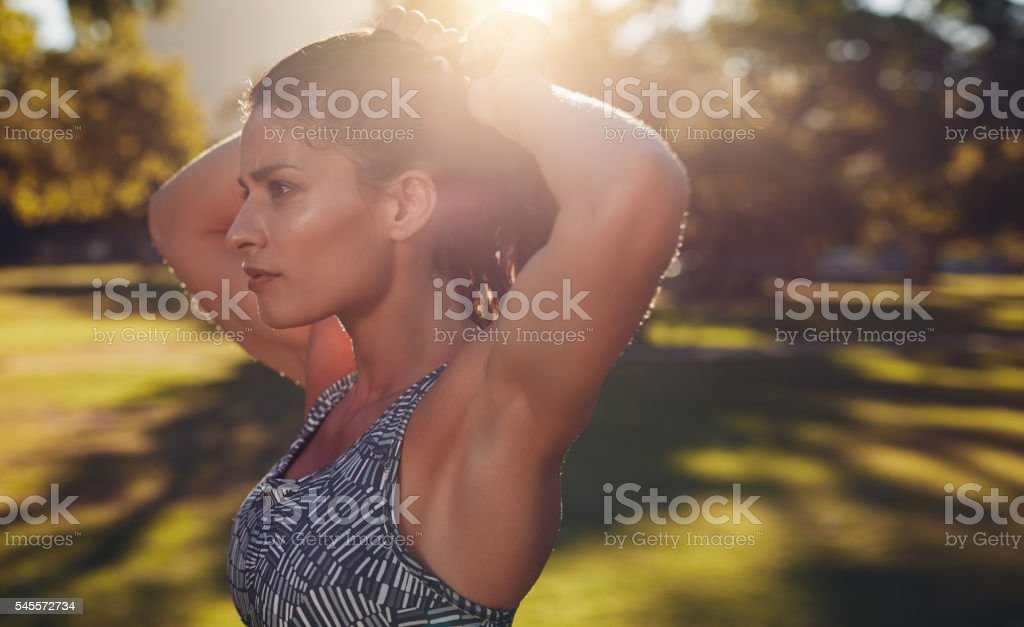 Tough young woman getting ready for training. stock photo