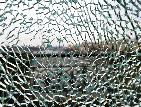 toughened glass in the cracks behind the bridge fence.