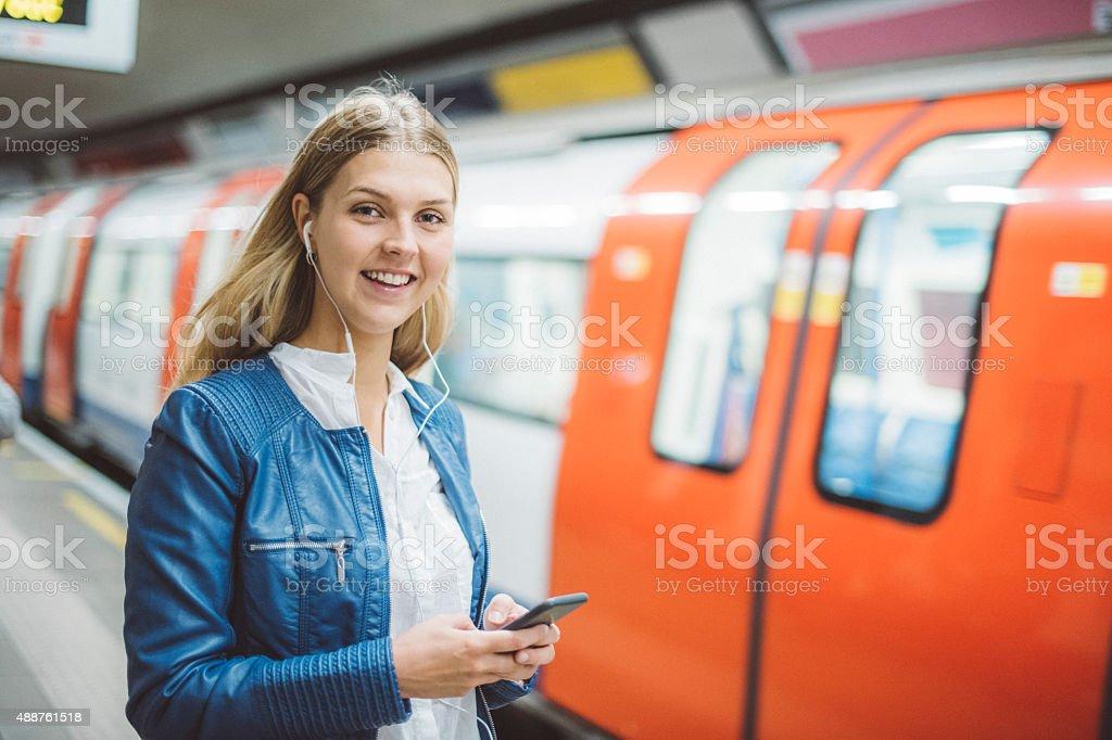 Toung woman on the tube stock photo