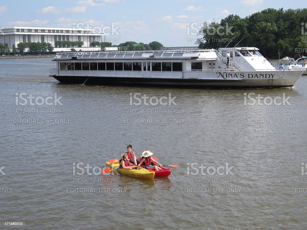 Tour Boat and Kayaks royalty-free stock photo