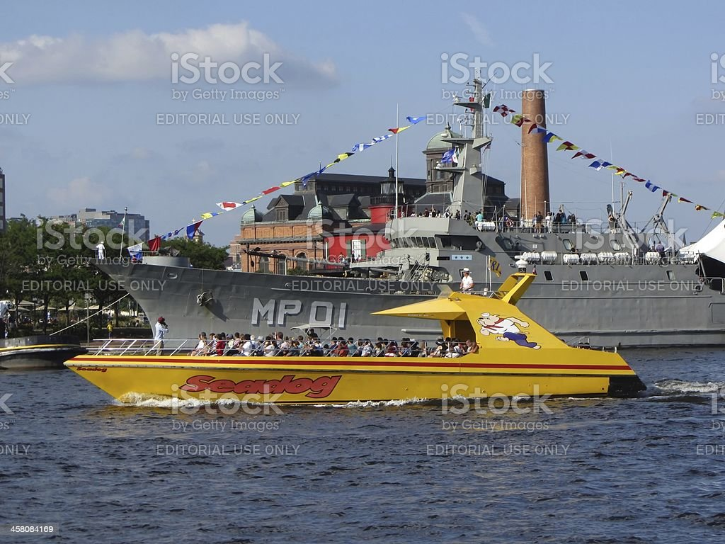 Tour Boat and Warship stock photo