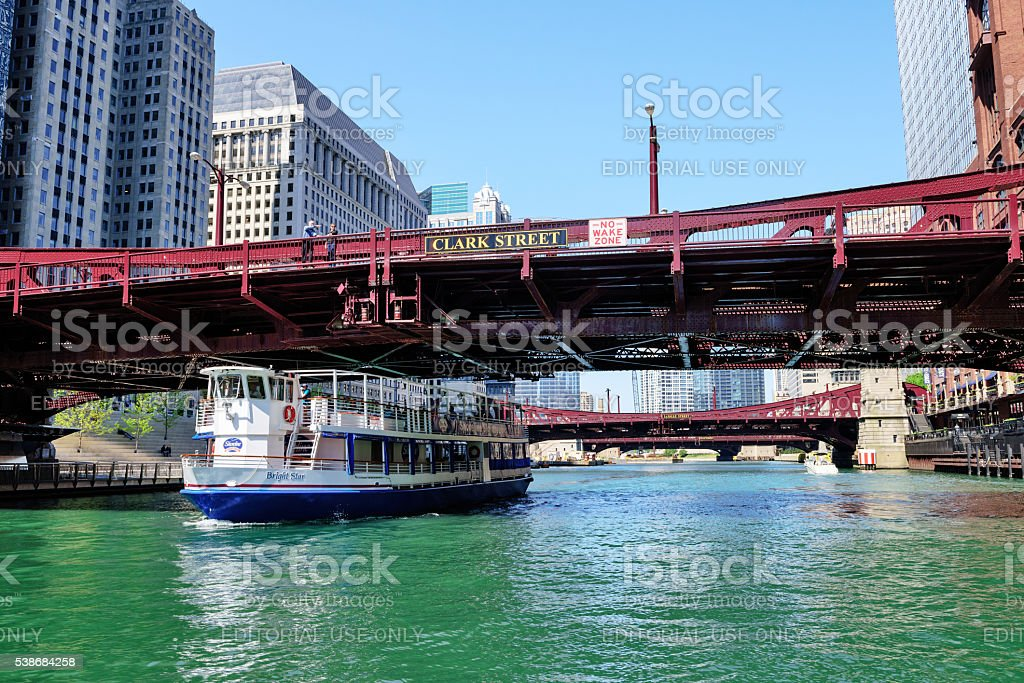Tour boat on Chicago River passing under  Bridge stock photo