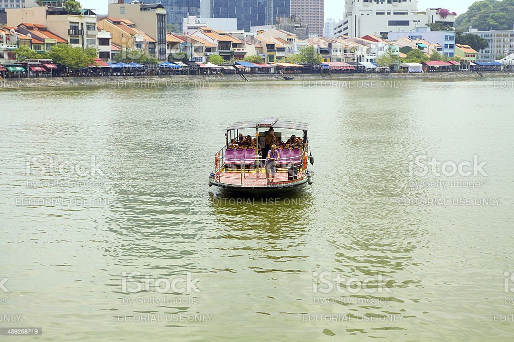 Tour boat passing Singapore royalty-free stock photo