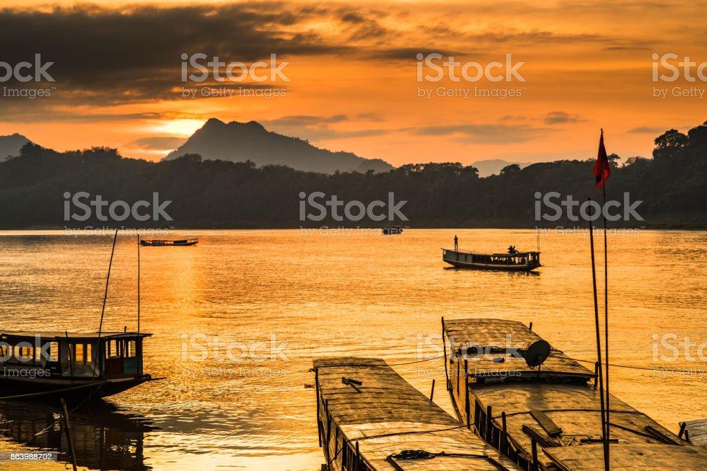 Tour boats in Mekong river, Luang Prabang stock photo
