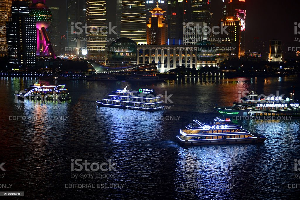 Tour boats in Shanghai at night stock photo