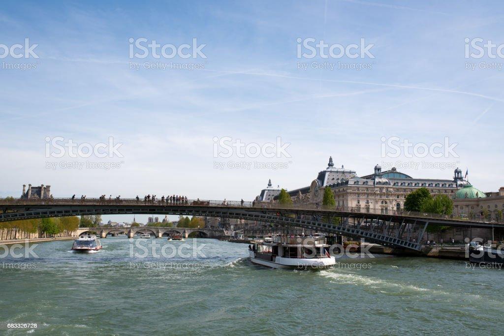 Tour boats under Leopold Sedar Senghor bridge on the Seine river in Paris stock photo