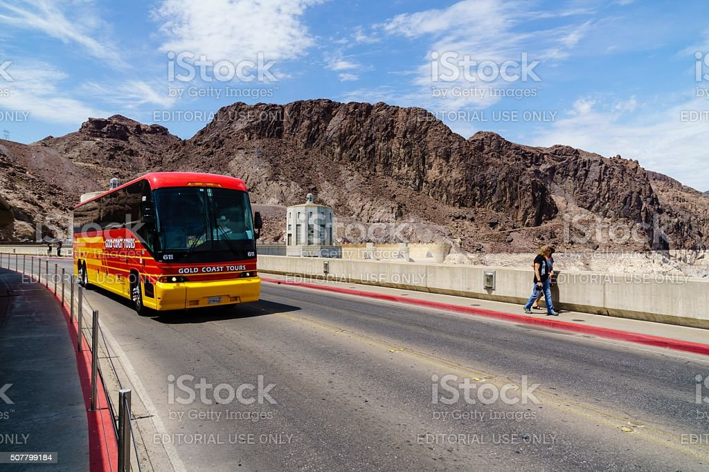 Tour Bus and People Crossing Hoover Dam in Nevada stock photo