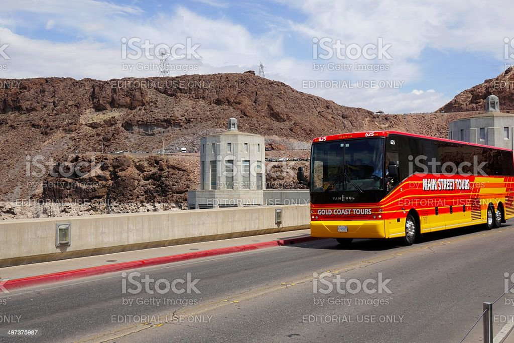Tour Bus Crossing Hoover Dam in Nevada stock photo