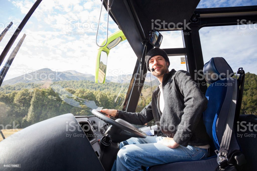 Tour Bus Driver in Fiordland National Park, New Zealand stock photo
