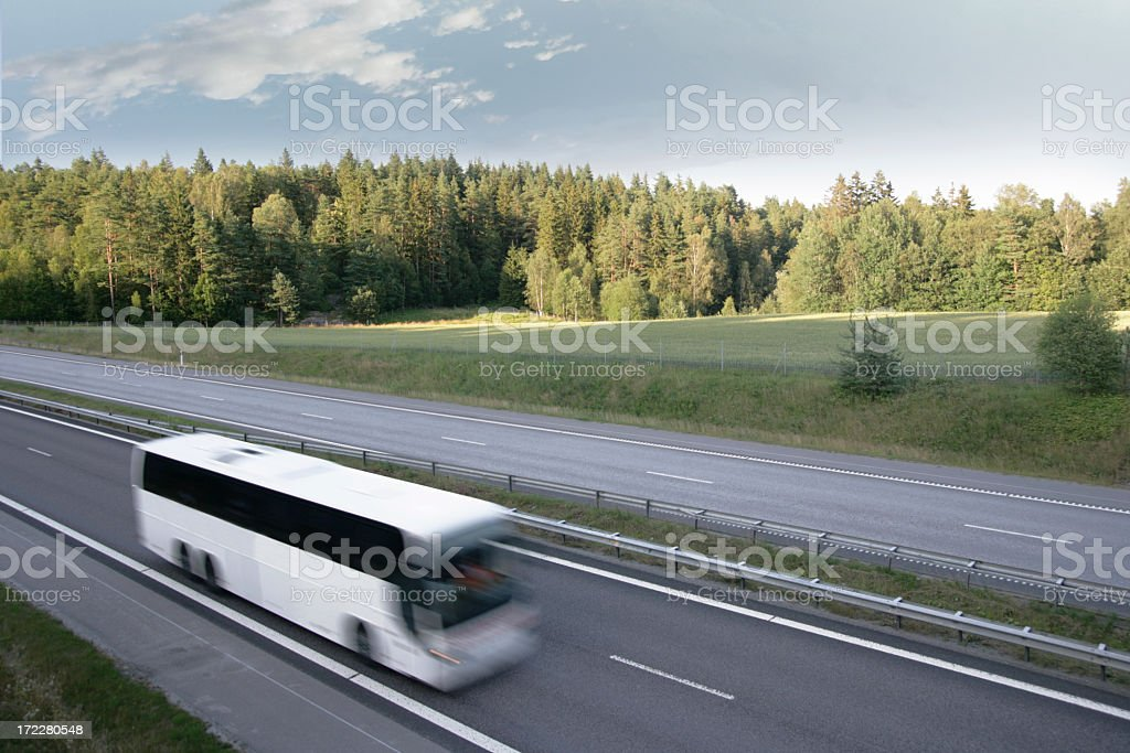 Tour bus in motion on a highway stock photo