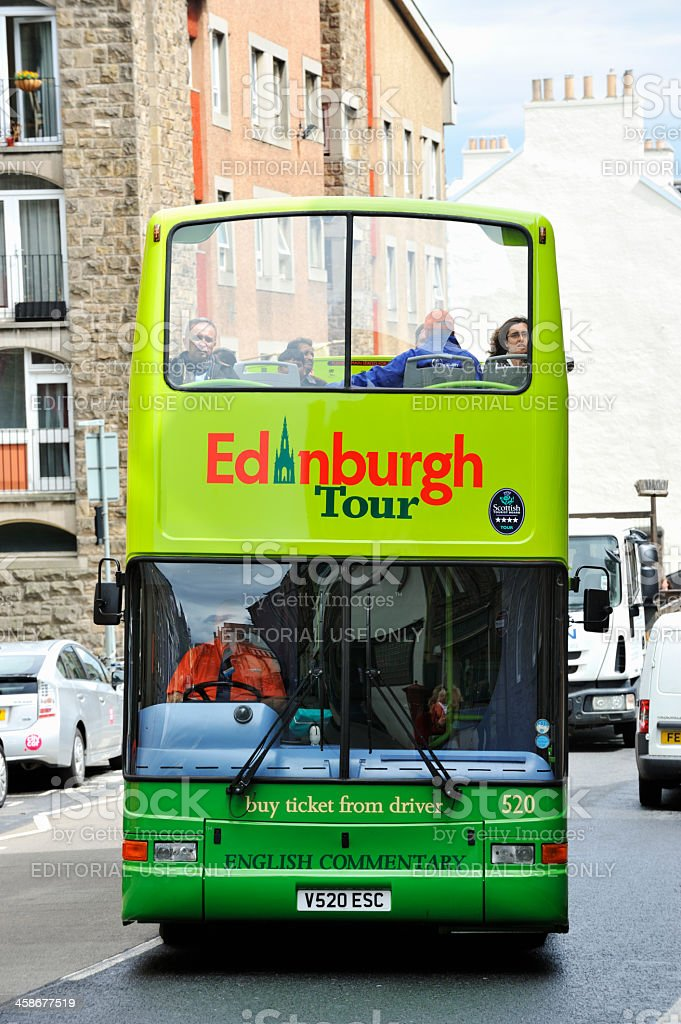 Tour bus on a historic city street in Edinburgh stock photo