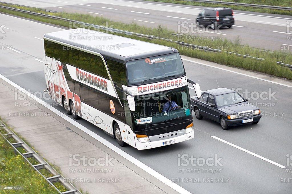 Tour bus on german Autobahn stock photo