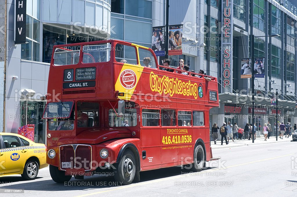 Tour bus on Yonge Street in Toronto stock photo