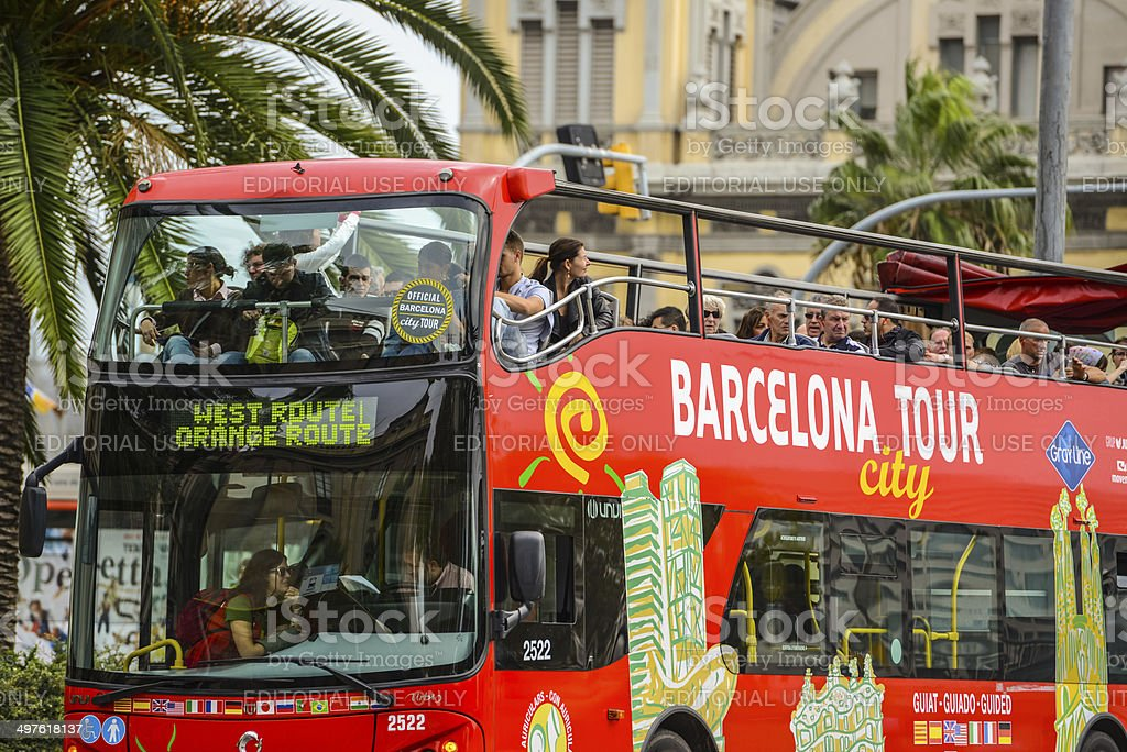Tour Bus with tourists in Port of Barcelona stock photo
