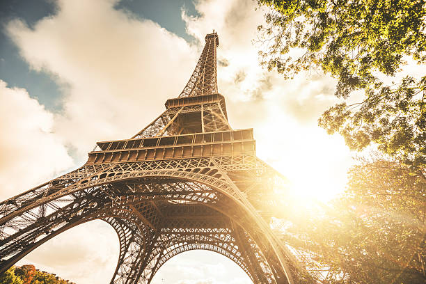 tour eiffel tower at sunset - eiffel tower stock photos and pictures