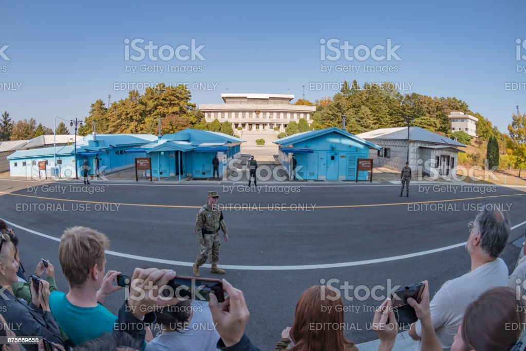 Tour group at the Joint Security Area DMZ conference buildings between South and North Korea stock photo