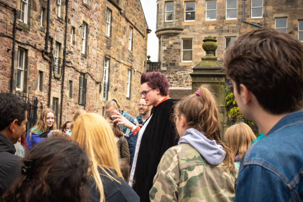 A tour guide leads a group of fans on a Harry Potter tour in Edinburgh stock photo