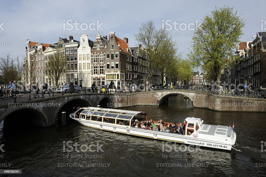 Tourboat in 17th century Keizersgracht, Amsterdam royalty-free stock photo