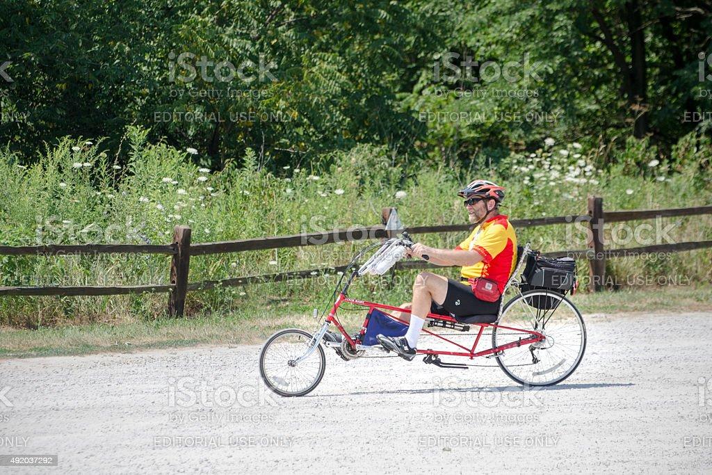 touring in rural Illinois on recumbent bicycle stock photo