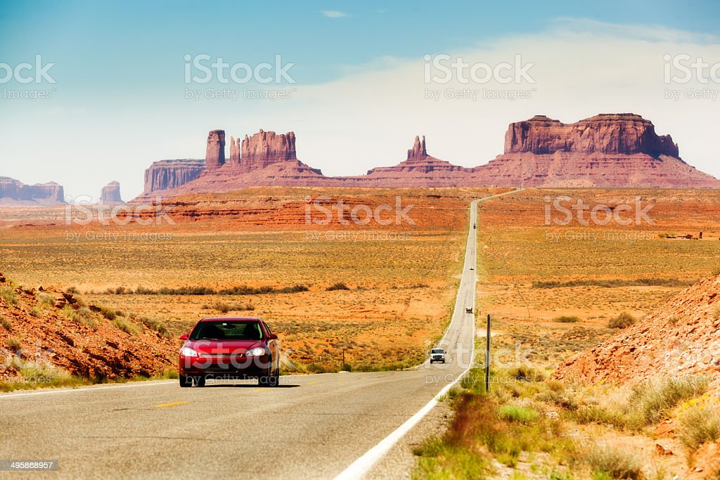 Touring the American Southwest, Monument Valley Highway with Cars royalty-free stock photo