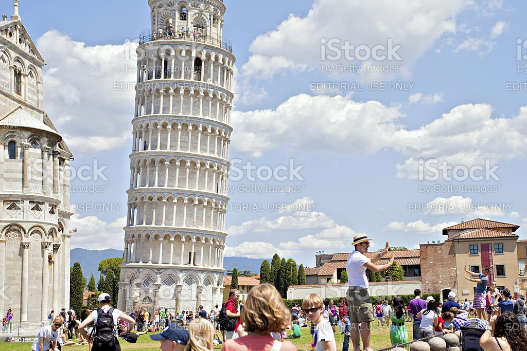 Tourism at the Leaning Tower of Pisa royalty-free stock photo