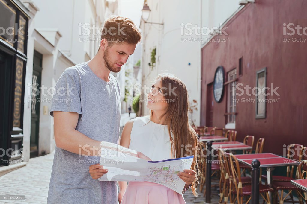 tourism, couple of tourists looking at the map stock photo