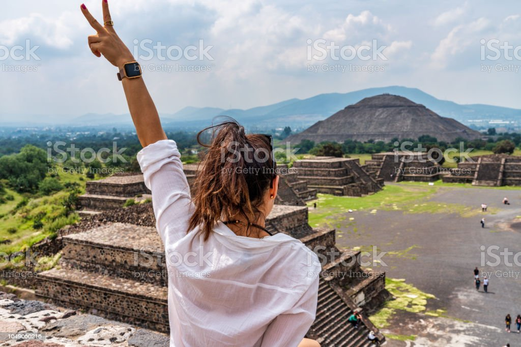 Tourism in Mexico - young adult tourist at ancient pyramids stock photo