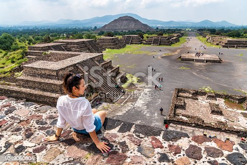 Tourism in Mexico City - young adult visits ancient Teotihuacan pyramids