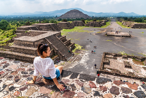 istock Tourism in Mexico - young adult tourist at ancient pyramids 1049060804