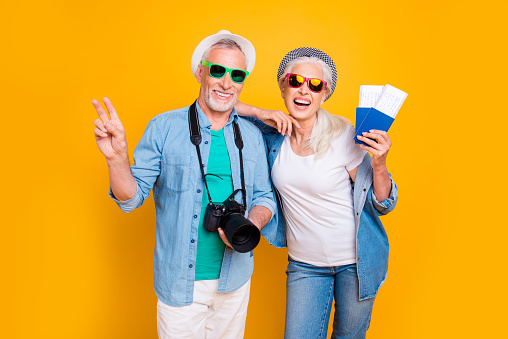 Tourism tourists traveler journey rest weekend vacation holiday relax concept. Photo portrait of excited guy two fingers digicam  lady vip passengers showing document with tickets isolated background