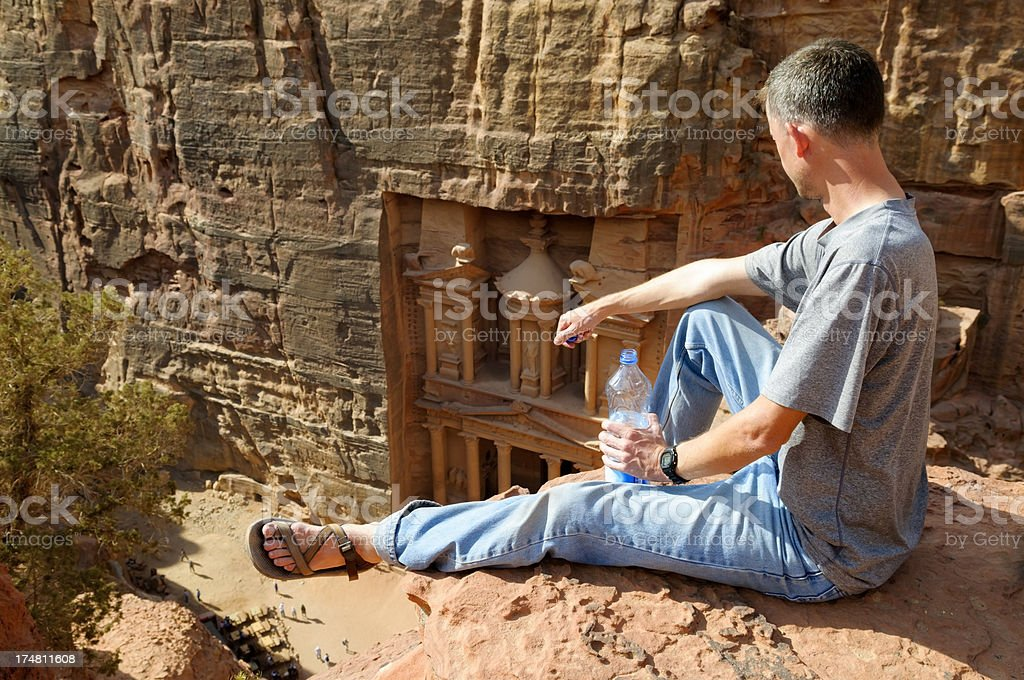 Tourist above the Treasury in Petra, Jordan royalty-free stock photo