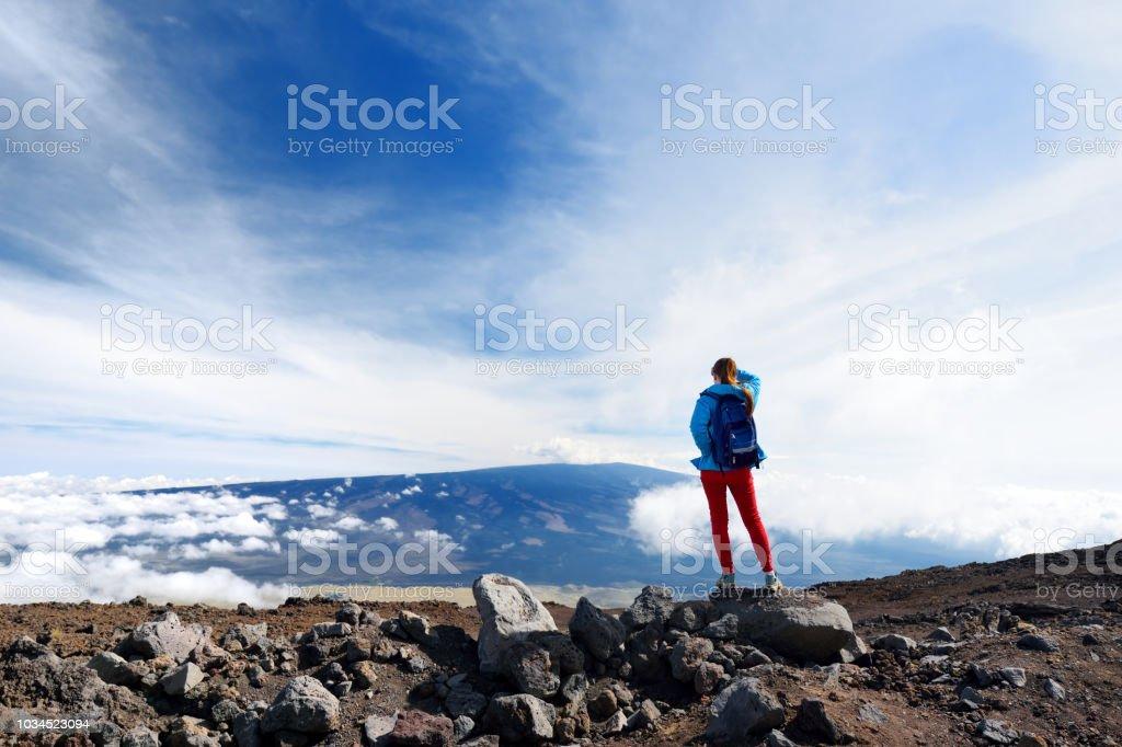 Tourist admiring breathtaking view of Mauna Loa volcano on the Big Island of Hawaii, USA stock photo
