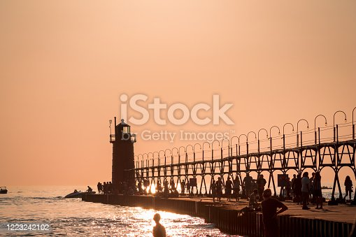 177362898 istock photo tourist and boaters near South Havens lighthouse at sunset in Michigan 1223242102