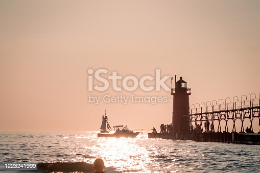 177362898 istock photo tourist and boaters near South Havens lighthouse at sunset 1223241999