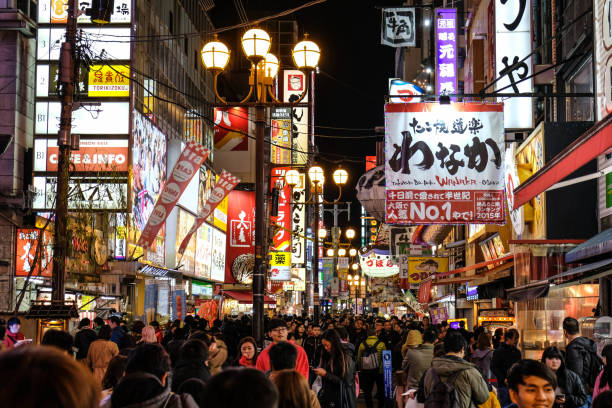 Tourist and crowd walking in night shopping street at Dotonbori stock photo