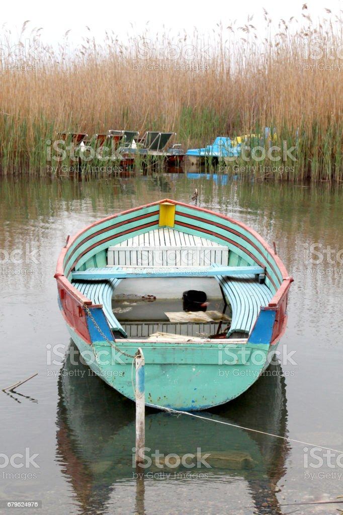 tourist and fisherman boats on lake ohrid in macedonia, royalty-free stock photo