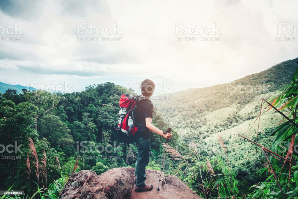 Tourist and Traveler Man with backpack the mountain  in forest stock photo