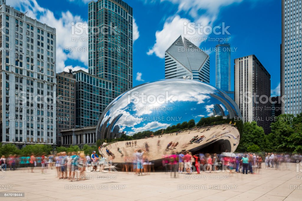 Tourist around the Cloud Gate ('The Beam') at the Millennium Park in Chicago, Illinois stock photo