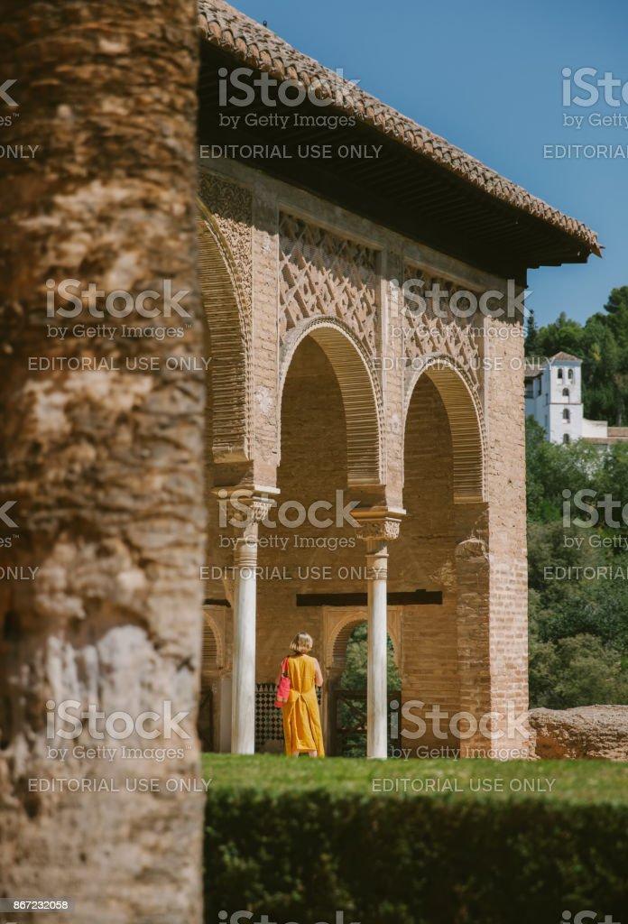 Tourist at Generalife gardens in Granada stock photo
