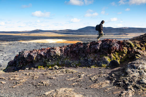Tourist at Krafla lava fields, Iceland stock photo