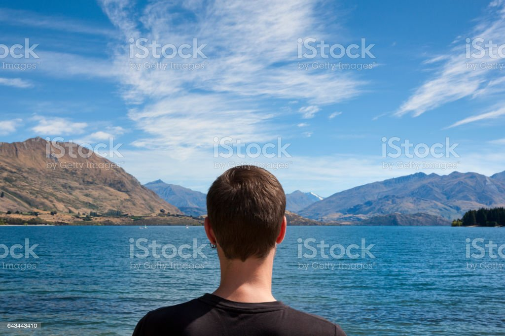 Tourist at Lake Wanaka in the Southern Alps of New Zealand stock photo