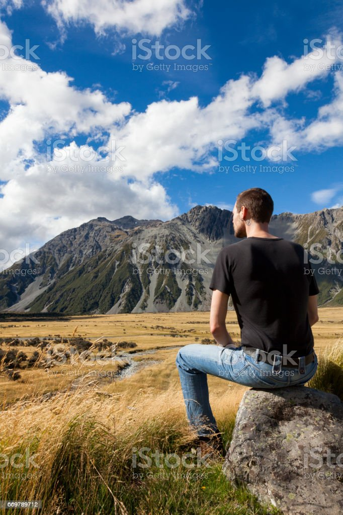 Tourist at Mount Cook of the Southern Alps in New Zealand stock photo
