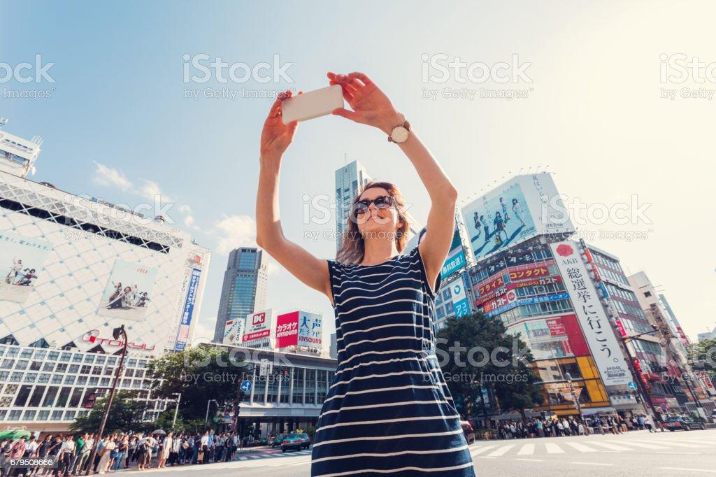 Tourist at Shibuya crossing royalty-free stock photo
