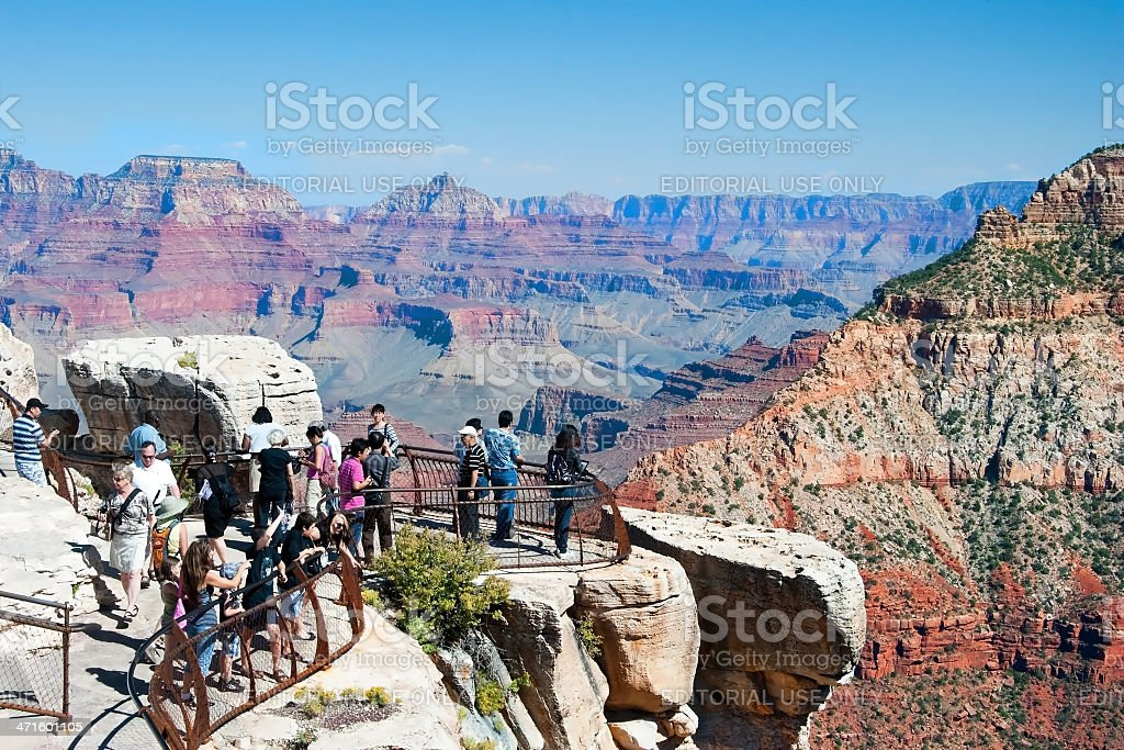 Tourist at south Rim of Grand Canyon in Arizona royalty-free stock photo