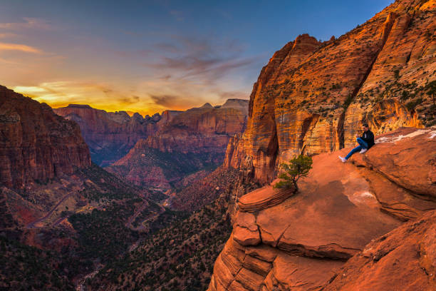 Tourist at the  Canyon Overlook in Zion National Park stock photo