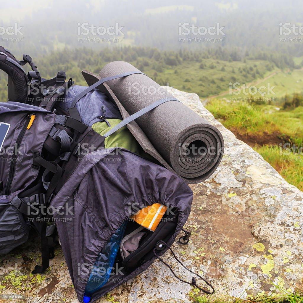 Tourist backpack on the stone at mountain top, Carpathian, Ukrai stock photo