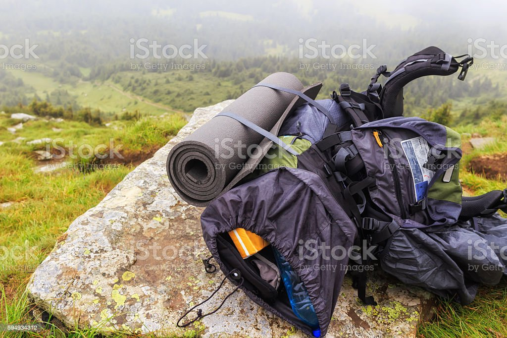 Tourist backpack on the stone at mountain top, Carpathian, Ukraine. stock photo