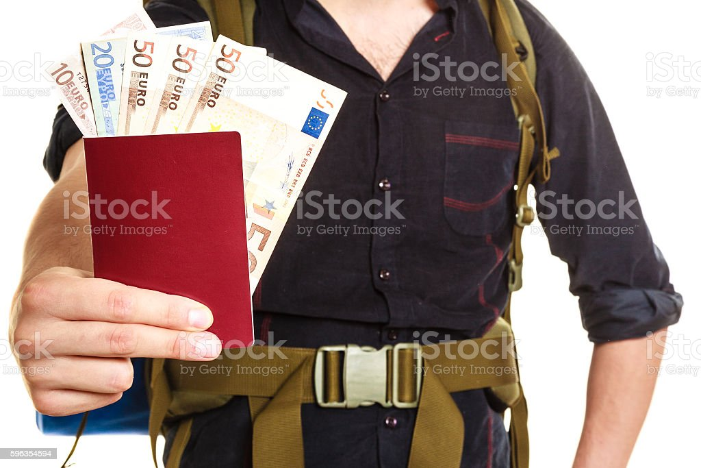Tourist backpacker holding money and passport. royalty-free stock photo