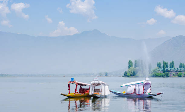 Tourist barges for romantic escapes on Srinagar Lake, a popular travel destination in Kashmir, India stock photo