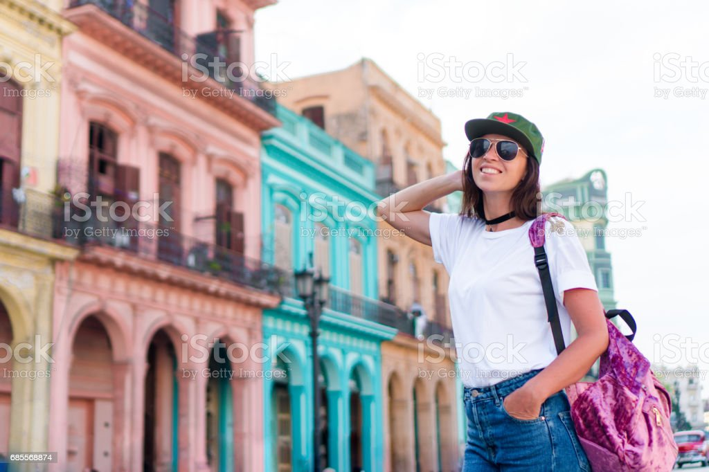 Tourist beautiful girl in popular area in old Havana, Cuba. Young woman traveler smiling happy. royalty-free 스톡 사진